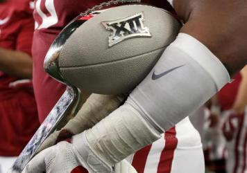 The Big 12 says its schools will start playing their conference games in late September, under a schedule that's been reduced due to the coronavirus. The conference hopes to hold a championship game in December.