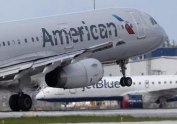 An American Airlines plane lands at the Fort Lauderdale-Hollywood International Airport on July 16, 2020. Air traffic has rebounded a bit but it's way below pre-coronavirus levels.