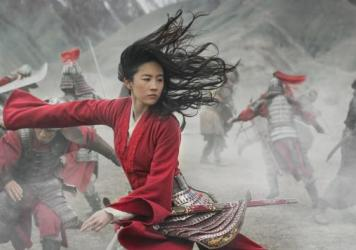 A gifted warrior (Liu Yifei) discovers her true purpose when China comes under attack by nomadic forces in <em>Mulan</em>.