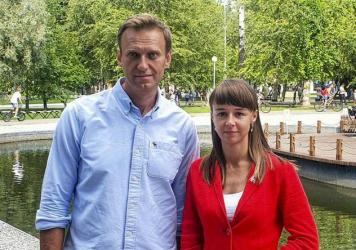 In this August photo, Alexei Navalny poses for a photo with Siberian politician Ksenia Fadeyeva. Navalny was removed from a medically-induced coma in a Berlin hospital after suffering what German authorities say was a poisoning with a chemical nerve agen