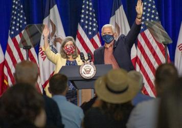 U.S. Sen. Joni Ernst, R-Iowa, appears on stage with Vice President Mike Pence in Des Moines on Aug. 13. Ernst is locked in a close race for reelection this fall against Democrat Theresa Greenfield.