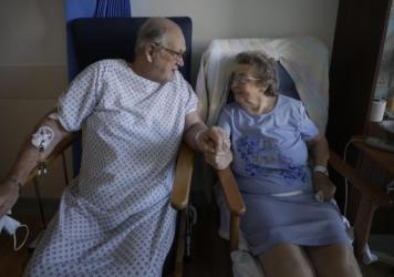 English coronavirus patients George Gilbert, 85, and his wife, Domneva Gilbert, 84, were part of a clinical trial that included Eli Lilly & Co.'s baricitinib.