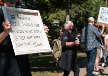 Protesters rally in front of Senate Majority Leader Mitch McConnell's home in Louisville, Ky., on Sunday. Soon after Justice Ruth Bader Ginsburg's death, McConnell said President Trump's court nominee will receive a vote in the Senate.
