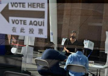 Many people who normally take on jobs as poll workers are in higher-risk groups for the coronavirus, leading to fears of a widespread shortage of poll workers. Here, New York City Board of Election employees and volunteers help voters at the Brooklyn Mus