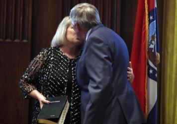 Gov. Mike Parson and his wife, Teresa, share a kiss after he was sworn in as Missouri's 57th governor in 2018.