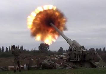 A howitzer fires munitions toward Armenian positions Monday. Violence between Armenia and Azerbaijan erupted Sunday in the disputed region of Nagorno-Karabakh.