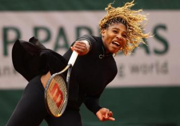 Serena Williams serves during her Women's Singles first round match against Kristie Ahn on day two of the 2020 French Open at Roland Garros on Monday in Paris, France.