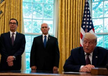 President Trump, flanked by Treasury Secretary Steven Mnuchin (left) and Vice President Pence last month in the Oval Office. Pence and Mnuchin are in the immediate line of succession if Trump is not able to perform his duties.