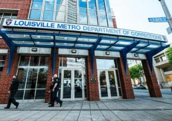 Kentucky's Jefferson County Circuit Court has released audio of the grand jury proceedings in the Breonna Taylor case. Here, police officers walk by the Louisville Metro Department of Corrections, which sits adjacent to Jefferson Square Park, the epicent
