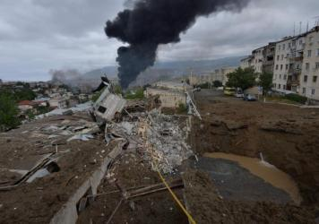 Smoke rises in the aftermath of recent shelling during the ongoing fighting between Armenia and Azerbaijan on Sunday.