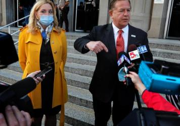 """""""The government chooses to persecute us for doing no more than exercising our right to defend ourselves, our home, our property and our family,"""" said Mark McCloskey, alongside his wife Patricia on Tuesday outside the Carnahan Courthouse."""