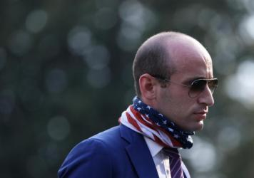 Stephen Miller walks on the South Lawn of the White House in July after returning from a trip to Morrisville, N.C.