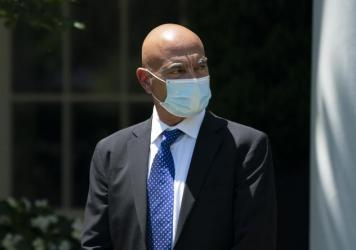 Operation Warp Speed's Moncef Slaoui, seen here at the White House in May, says clinical trials of experimental COVID-19 vaccines will soon reveal if they work. Meanwhile, manufacture of the vaccines is picking up speed.