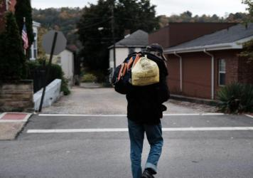 A homeless man walks downtown in East Liverpool, Ohio. Efforts to register homeless voters in the state have relied on churches and shelters volunteering to receive mail-in ballots for people with no permanent address.