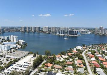 A new study has found that home sale prices and volume appear to be declining in Florida coastal areas at vulnerable to rising sea levels compared to coastal areas with less risk. Here, the balcony view from a luxury condo in Sunny Isles Beach, Fla., in
