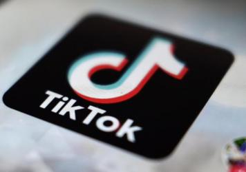 TikTok says it is banning all accounts that share content related to the QAnon conspiracy theory, hardening its previous policy on the far-right movement.