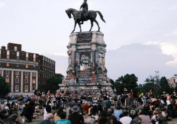 The Robert E. Lee statue on Richmond's Monument Avenue is seen here during a violin vigil to remember Elijah McClain in July.