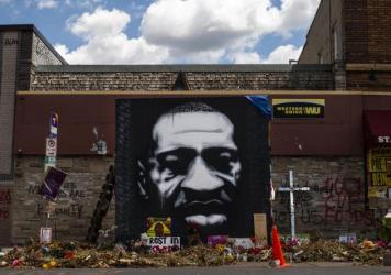 A mural honors George Floyd at the intersection of 38th St. and Chicago Ave., where he was killed by Minneapolis police on May 25, inspiring protests and police reform efforts.