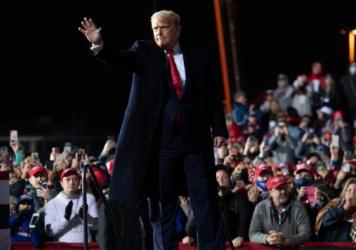 President Trump waves at the end of a rally at Erie International Airport in Erie, Pa., on Tuesday evening.