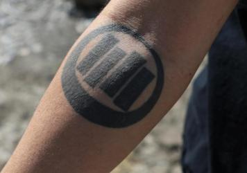 Parker shows off a vestige of his old punk phase: a Black Flag tattoo, symbolizing rebellion against authority. He recalls his days as a mohawk-wearing youth scrapping with neo-Nazis in Phoenix, Ariz.