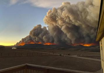 People near Rocky Mountain National Park have evacuated and the park was closed after one of several fires burning in northern Colorado exploded late Wednesday. A resident took this photo from her home north of Granby, Colo., on Wednesday.