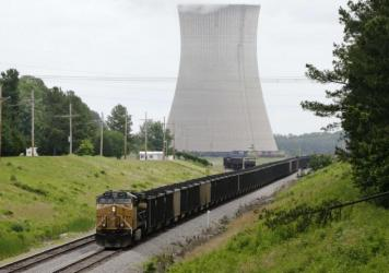 A coal train stops near the White Bluff Plant near Redfield, Ark. in 2014. Entergy Arkansas agreed to eventually stop using coal at this and another plant under a settlement with environmental groups, but a dark money nonprofit funded by Wyoming is pushi