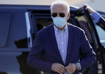 Democratic presidential candidate Joe Biden walks to board his campaign plane in New Castle, Del., earlier this month.