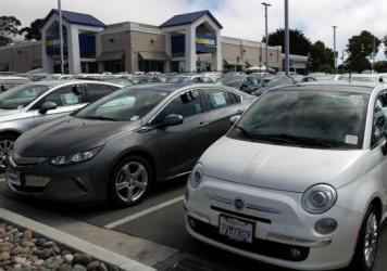 Used vehicles are parked on the sales lot at a CarMax store on Sept. 24 in Colma, Calif. CarMax reported a surge in earnings after used-car prices climbed steadily — and surprisingly — for months.