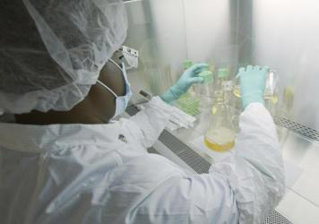 An Eli Lilly researcher tests possible COVID-19 antibodies in a laboratory in Indianapolis.