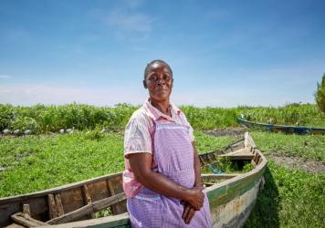 Alice Amonde sits on a boat on the village of Nduru Beach, Kenya. She is part of the group of women who have fought against the practice of transactional sex that was part of the fishing business. This photograph was taken in November 2019. This spring,