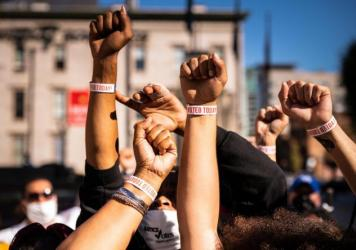 "Black Lives Matter protesters display wristbands reading ""I Voted"" after leaving a polling place this month in Louisville, Ky. Activists warn Black and Latino voters are being flooded with disinformation intended to suppress turnout in the election's fin"