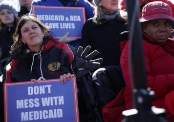 Health care activists rallied in front of the U.S. Capitol on March 22, 2017, to protest Republican efforts that would have dismantled the Affordable Care Act and capped federal payments for Medicaid patients. The Republican congressional bills, part of