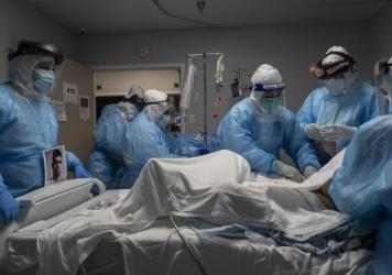 Medical staff members treat a patient with COVID-19 last week in the intensive care unit of United Memorial Medical Center in Houston. Once a COVID-19 vaccine is available, experts say immunizing health workers first is the best way to curb deaths and st