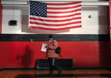 A voter casts a ballot on Tuesday at Jennings Senior High School in Jennings, Mo., a St. Louis suburb. Voters passed an amendment to Missouri's constitution that opens the door to redrawing state legislative districts that don't take into account childre