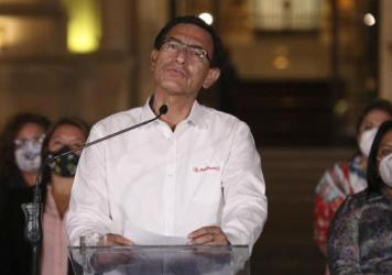 Peru's President Martín Vizcarra speaks in front of the presidential palace after lawmakers voted to remove him from office in Lima, Peru, Monday. Peruvian lawmakers voted overwhelmingly to impeach Vizcarra, expressing anger over his handling of the cor