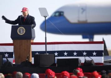 President Trump delivers remarks during a campaign rally at Fayetteville Regional Airport in North Carolina on the night before Election Day.