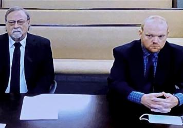 Lawyers for father and son, Gregory and Travis McMichael, asked for a judge to grant bond for the pair, saying the elder McMichael was not motivated by race and that the younger man, never gets into trouble. But Judge Timothy Walmsley on Friday denied th
