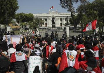 Protesters gather outside Congress in Lima, Peru, after interim President Manuel Merino announced his resignation following massive protests unleashed when lawmakers ousted President Martín Vizcarra.
