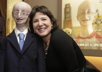 "Sam Berns and Audrey Gordon, executive director of The Progeria Research Foundation and Berns's aunt, attend The New York Premiere Of HBO's ""Life According To Sam"" on October 8, 2013 in New York City."