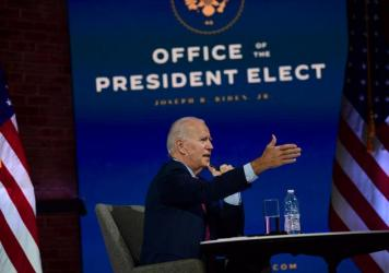 President-elect Joe Biden speaks Monday in Wilmington, Del., during a virtual meeting with the U.S. Conference of Mayors.