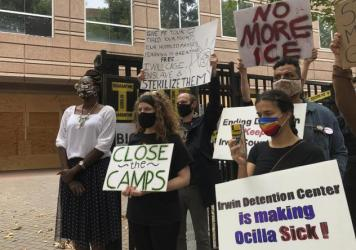 Protesters gather for a news conference in Atlanta earlier this year, shortly after the release of a complaint by whistleblower Dawn Wooten, a nurse at Irwin County Detention Center in Ocilla, Ga.