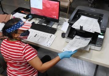 An election worker scans mail-in ballots at the Clark County Election Department on Oct. 20 in North Las Vegas.