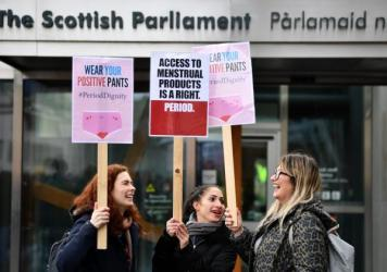 Activists rally outside the Scottish Parliament in Edinburgh in February in support of legislation for free period products. Scotland will make these products free to all who need them after lawmakers unanimously passed a bill that will require tampons a