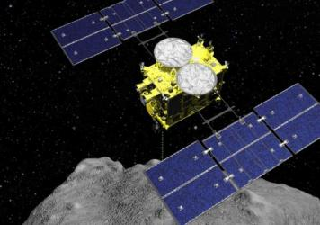 This computer-generated image shows the Hayabusa2 spacecraft above the asteroid Ryugu. This weekend, the sample collected by the spacecraft arrived on Earth after a six-year mission.