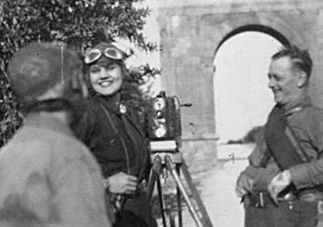 """Adventurer and filmmaker Aloha Wanderwell working on her 1929 film """"With Car and Camera Around the World,"""" which joined the National Film Registry this year."""