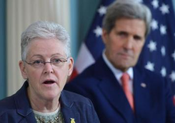 Then-Environmental Protection Agency Administrator Gina McCarthy speaks during a 2015 signing ceremony for an air quality agreement as then-Secretary of State John Kerry looks on. The two will be back together working on climate issues in the Biden admin