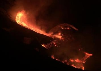 Lava cascades into the summit water lake at the Kilauea volcano on Hawaii's big island. The eruption began late Sunday within the volcano's Halemaumau crater, at the summit of Kilauea.