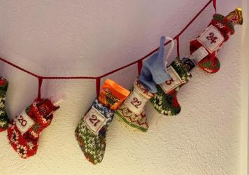 "Kathleen Murray gave family members Advent calendars that, alongside candy, included hand sanitizer and masks. ""It's the closest thing to safety that you can give them,"" she said."