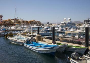 Many Americans are visiting Mexico's beaches during the pandemic. Above, fishing boats are docked at a marina in Los Cabos, Mexico, on June 2.
