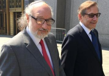 Convicted spy Jonathan Pollard, left, with his lawyer, Eliot Lauer, leaves federal court in New York following a 2016 hearing. The former U.S. Navy analyst who spent three decades in prison after pleading guilty to spying for Israel, has arrived in Israe